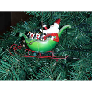 Sledding Santa & Penguins Ornament